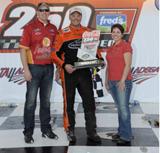 Mike Wallace with Steve and Alison Anderson after his victory at Talladega in 2011